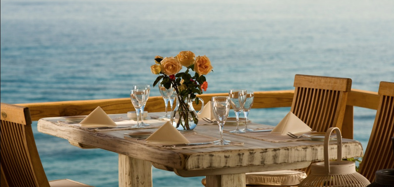 Table set for dinner in front of teh sea